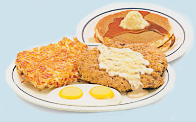 Country Fried Steak & Eggs Bistec Compestre Frito y Huevos A golden battered beef steak smothered in country gravy. Served with 2 eggs, hash browns & 2 buttermilk pancakes. 10.791710 calories